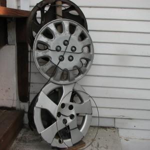 Upcycler #9 (Guard); hubcaps, detritus; 2014