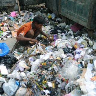 An Indian ragpicker searches for re-cycl